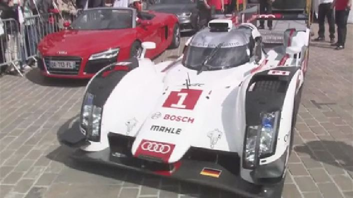 Audi presents the new R18 in urban traffic at Le Mans